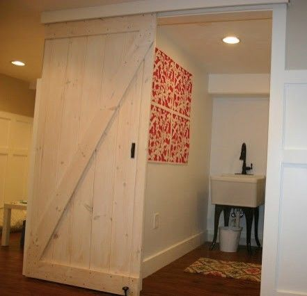 Katos for a Traditional Basement with a Barn Door Laundry Room and Basement Renovation by Christina Katos