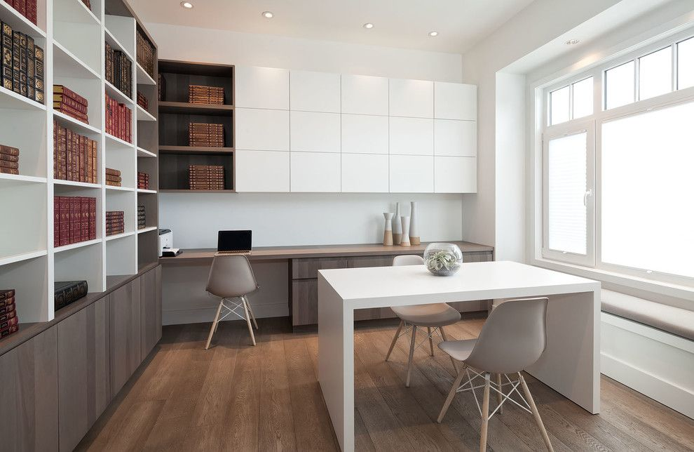 Kentwood Flooring for a Scandinavian Home Office with a Kentwood and Elm Street Residence by Area3 Design Studio Inc.