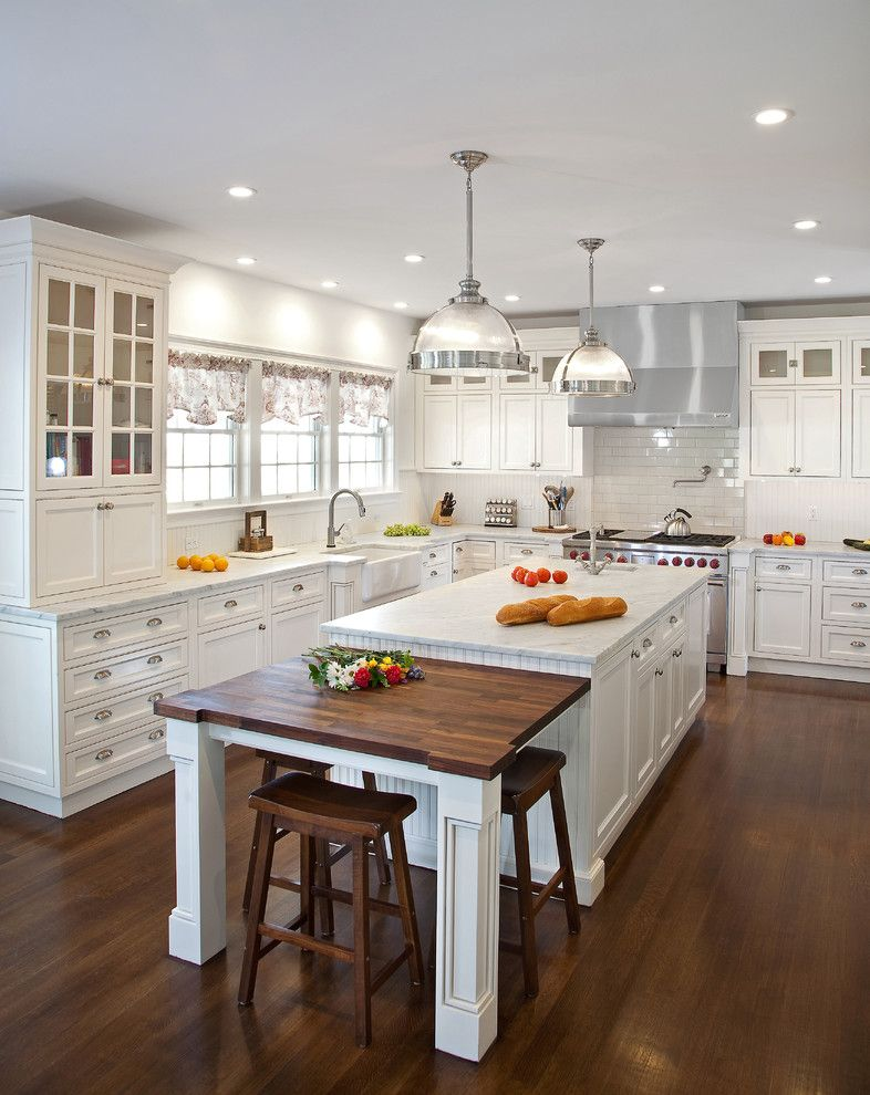 Kichen for a Traditional Kitchen with a Glass Cabinets and Transitional White Kitchen in Ny by Kuche+Cucina