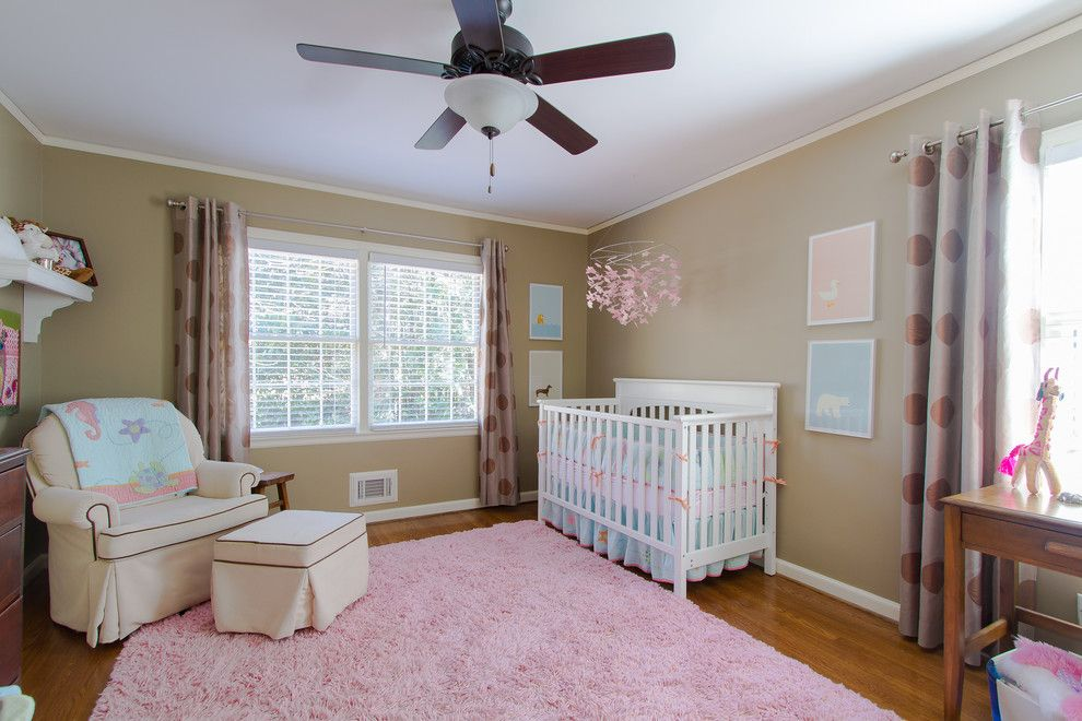 Kick Pleat for a Traditional Nursery with a Ceiling Fan and Buckhead 3 by Abbey Construction Company, Inc.