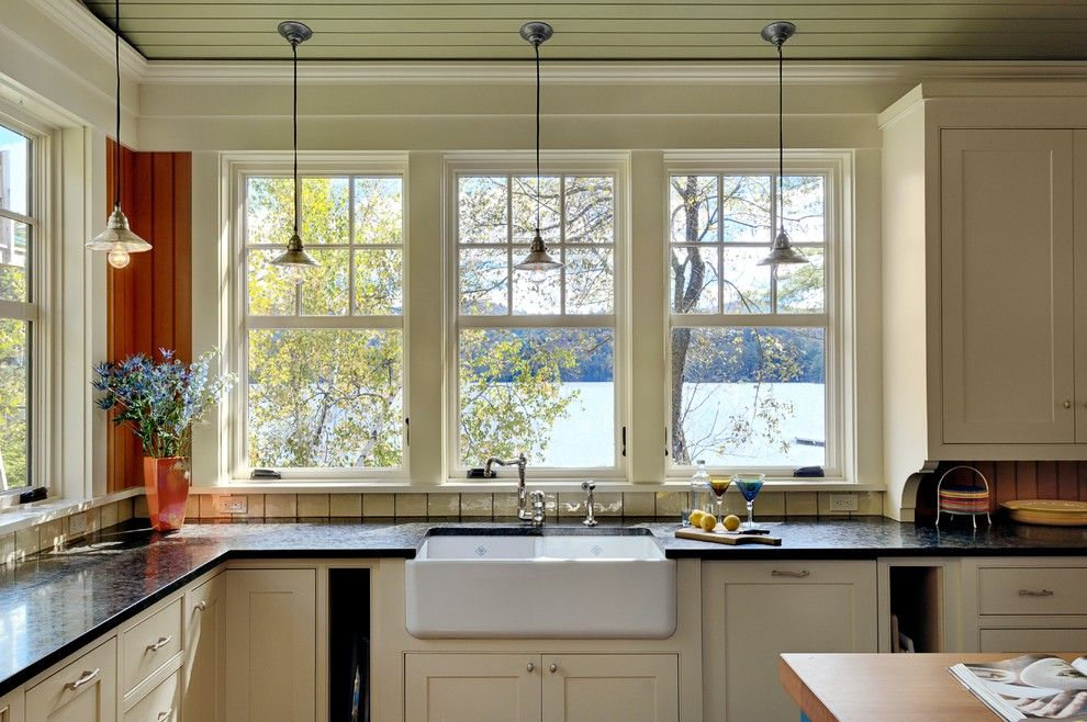 Kitchen Sink Lyrics for a Rustic Kitchen with a Lake House and Summer Lake House by Smith & Vansant Architects Pc