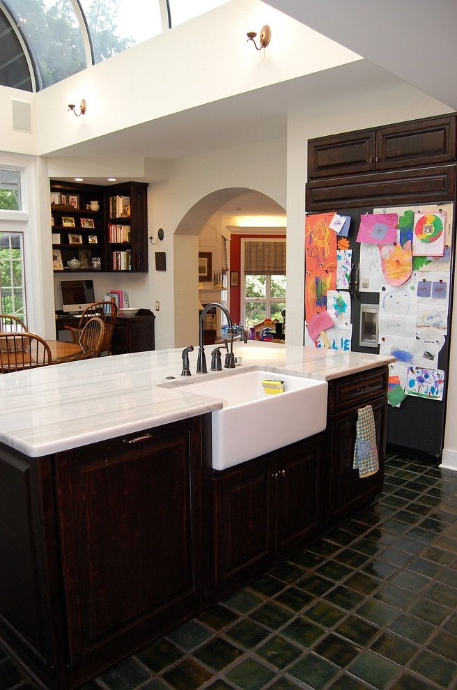 Kitchen Sink Lyrics for a Traditional Kitchen with a Black Appliances and Private Residence by Leslie Stephens Design