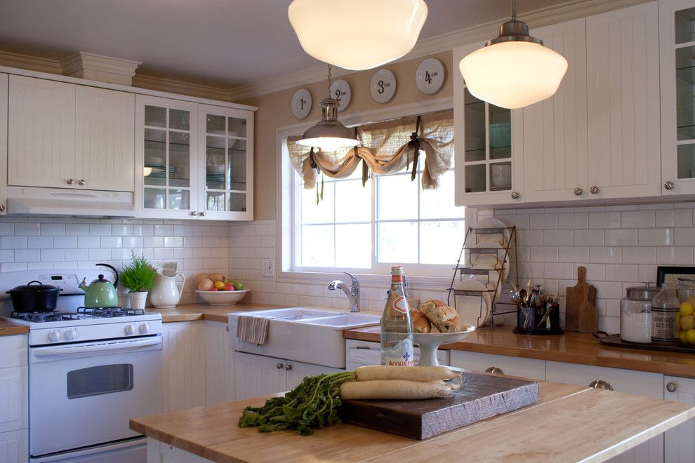 Kitchen Sink Lyrics for a Traditional Kitchen with a Glass Cabinets and Farmhouse Kitchen by Jennifer Grey Interiors