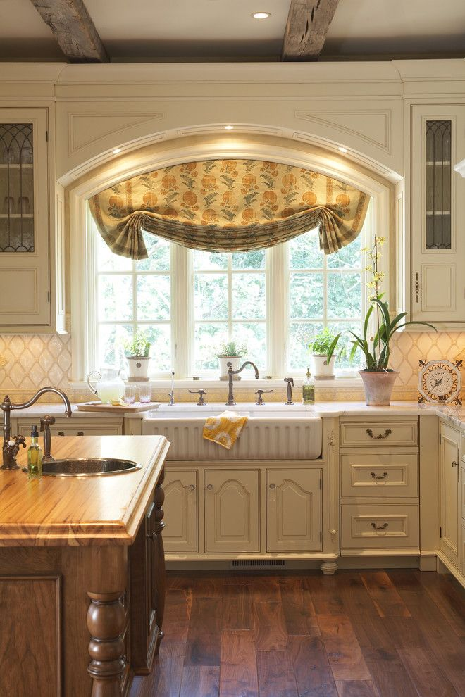 Kitchen Sink Lyrics for a Traditional Kitchen with a Kitchen Faucet and Kitchen by Hendel Homes