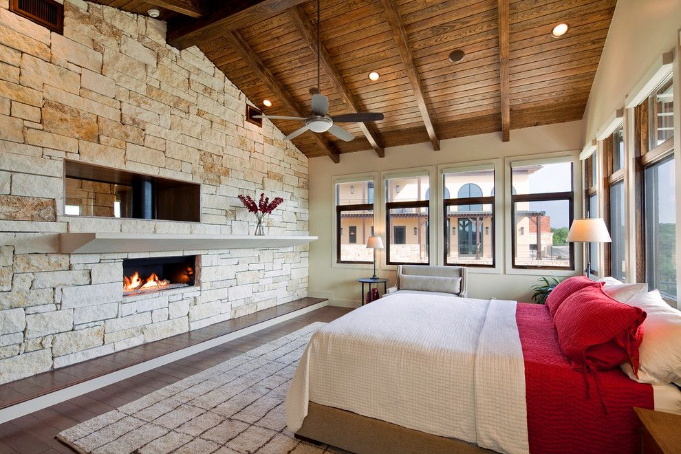 Knock Down Ceiling for a Mediterranean Bedroom with a Exposed Beams and Master Bedroom by Jenkins Custom Homes