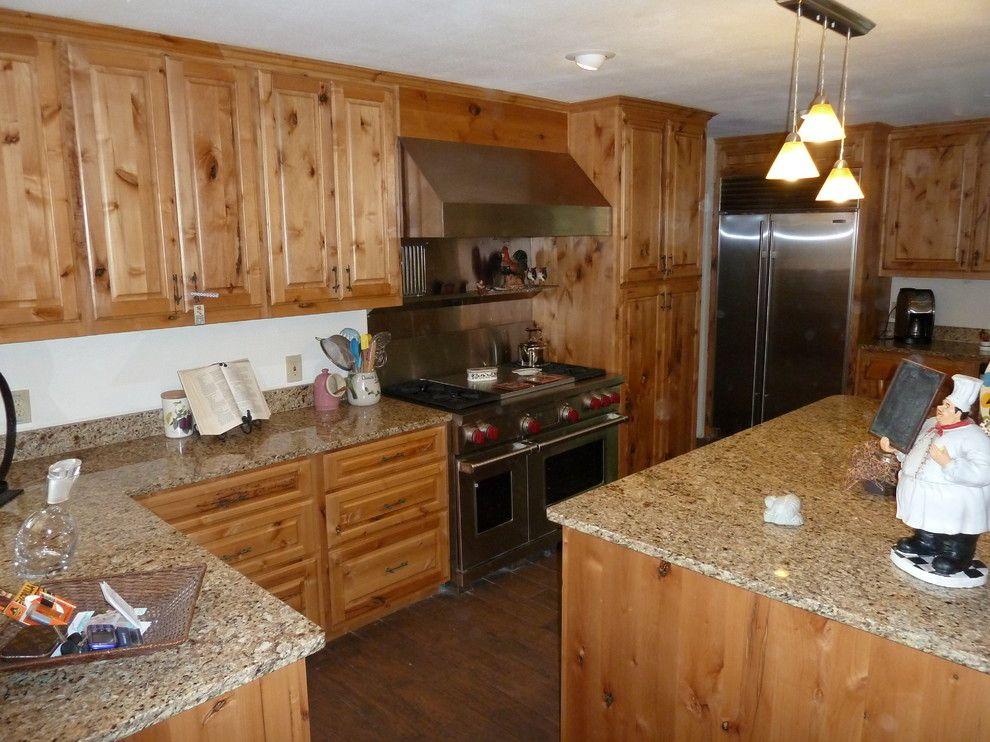 Knotty Alder Cabinets for a Eclectic Kitchen with a Eclectic and Knotty Alder Cabinets by Lone Star Remodeling and Renovations