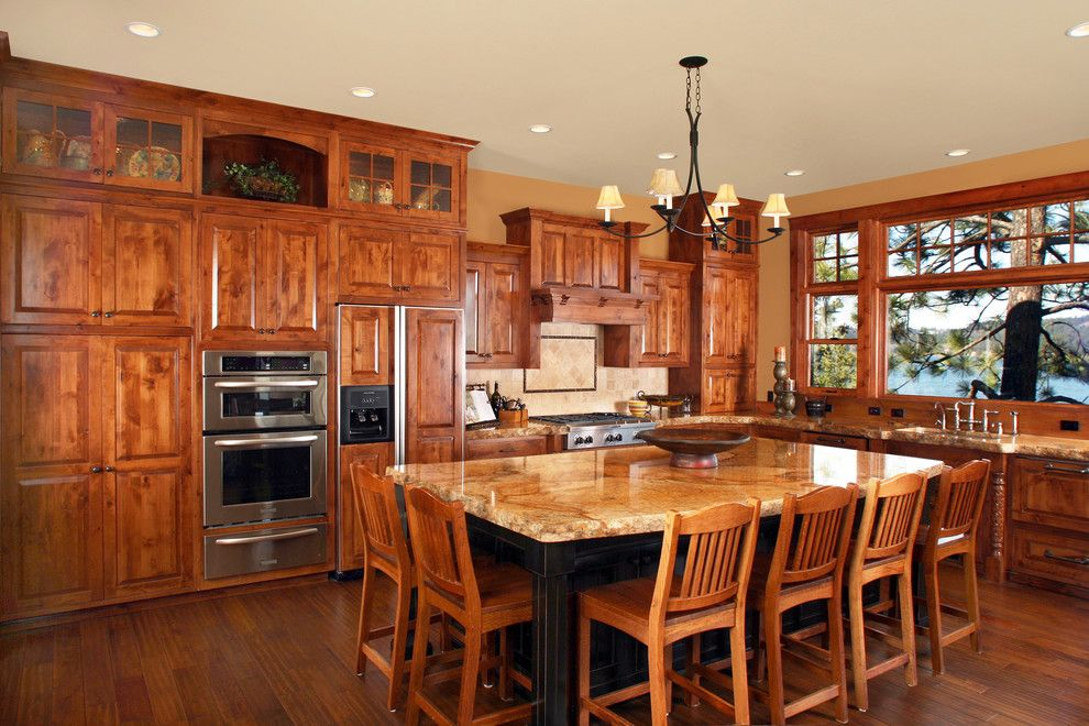 Knotty Alder Cabinets for a Rustic Kitchen with a Custom Hood and Harrison Idaho by Wingren Design