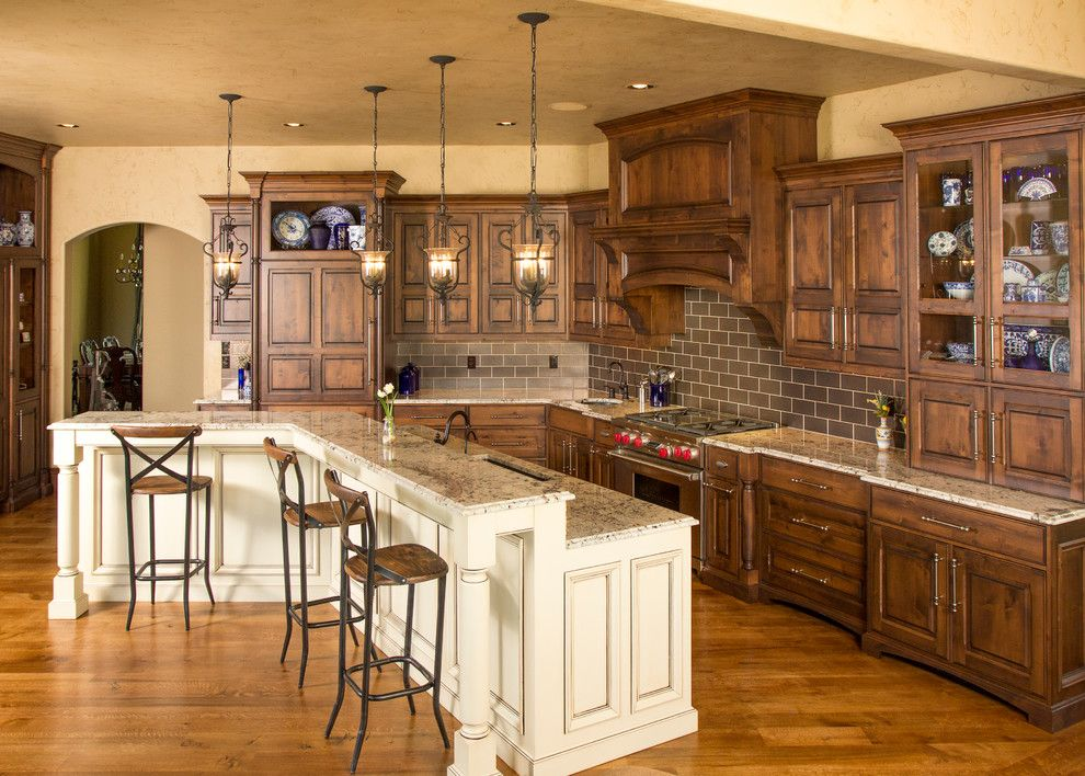 Knotty Alder Cabinets for a Traditional Kitchen with a Large Island and Beaded Inset Cabinetry by Wende Woodworking Llc