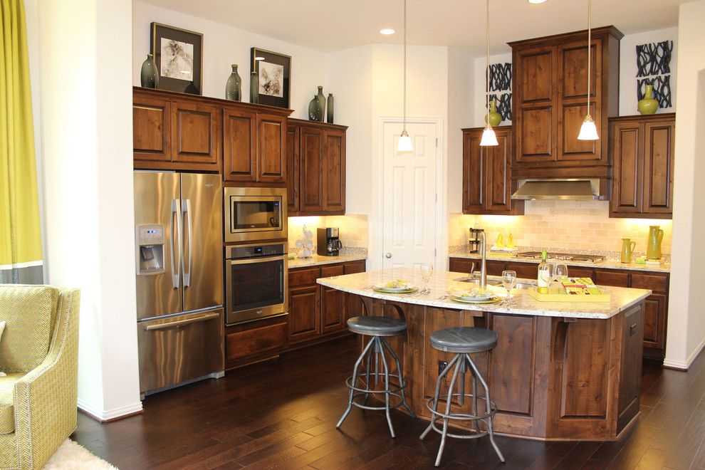 Knotty Alder Cabinets for a Traditional Kitchen with a Raised Panel and Model Home Kitchen with Knotty Alder Cabinets by Taylorcraft Cabinet Door Company
