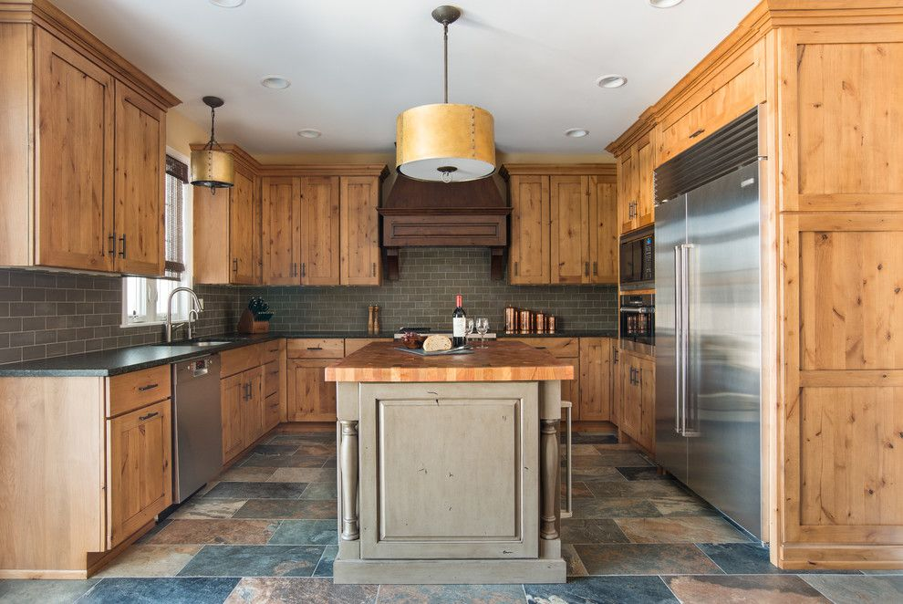 Knotty Pine for a Rustic Kitchen with a Slate and Warm and Rustic Remodel by Kristin Petro Interiors, Inc.
