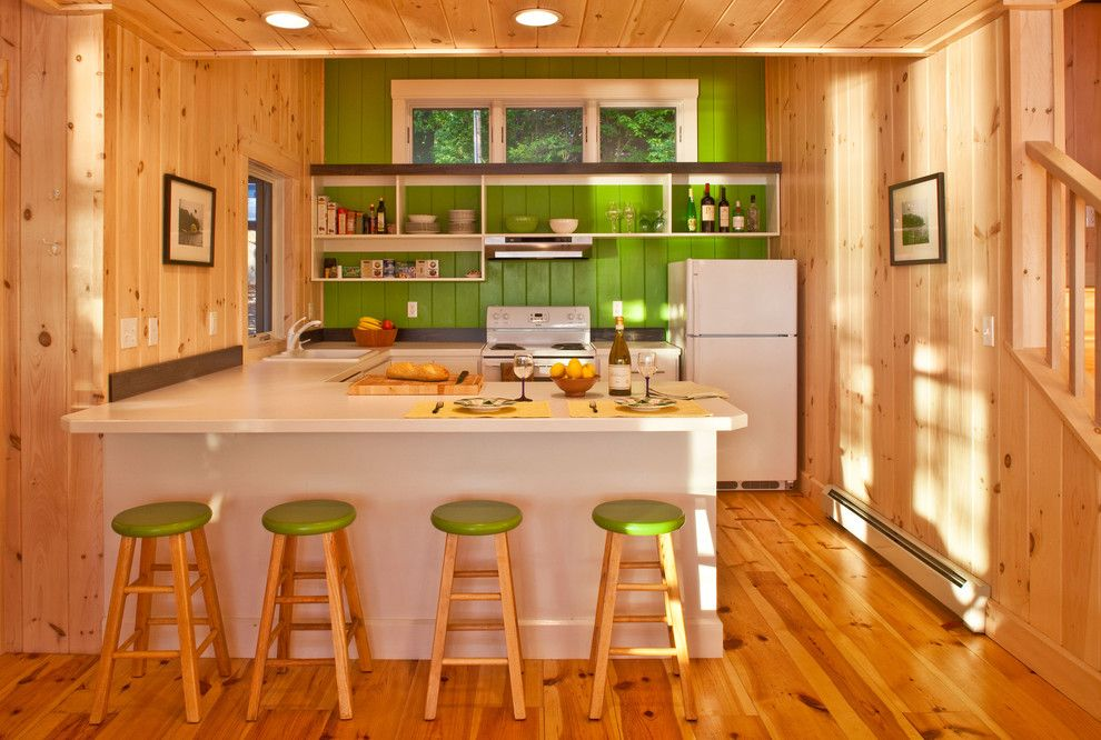 Knotty Pine for a Rustic Kitchen with a Wood Flooring and Highland Lake House Kitchen by Kaplan Thompson Architects