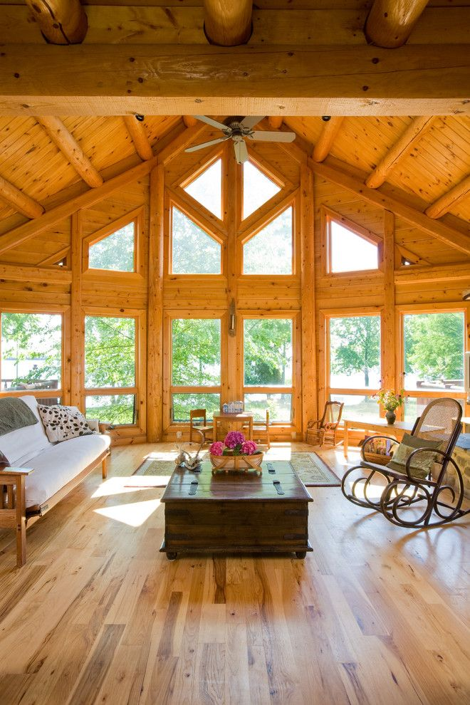 Knotty Pine for a Traditional Living Room with a Wood Rocking Chair and Chesapeake Bay Waterfront Log Home by Katahdin Cedar Log Homes