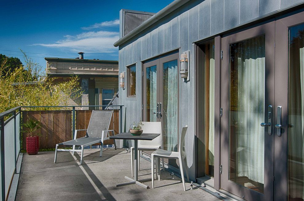 Knox Rail Salvage for a Modern Deck with a Wood Railing and Mixed Use Elegance by Louise Lakier