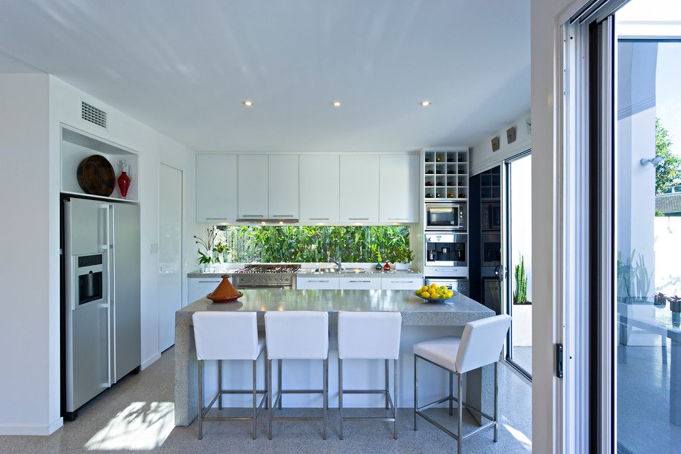 Kodiak Steel Homes for a Contemporary Kitchen with a Sliding Glass Door and Hendra by Civic Steel Homes