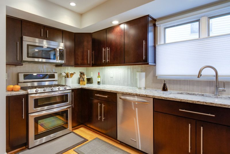 Kona Kitchen for a Modern Kitchen with a Maple Cabinets and Modern Makeover in Fairfax, Va by Reico Kitchen & Bath