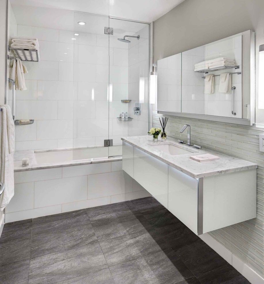 Kraus Flooring for a Contemporary Bathroom with a Glass Shower Shield and Bowery Downtown Manhattan Residence by United Elite Group