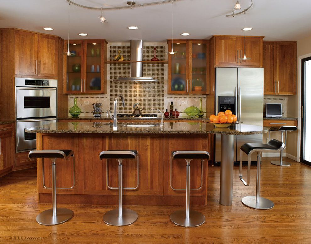 Kraus Flooring for a Contemporary Kitchen with a Flat Panel and Kitchen Cabinets by Capitol District Supply
