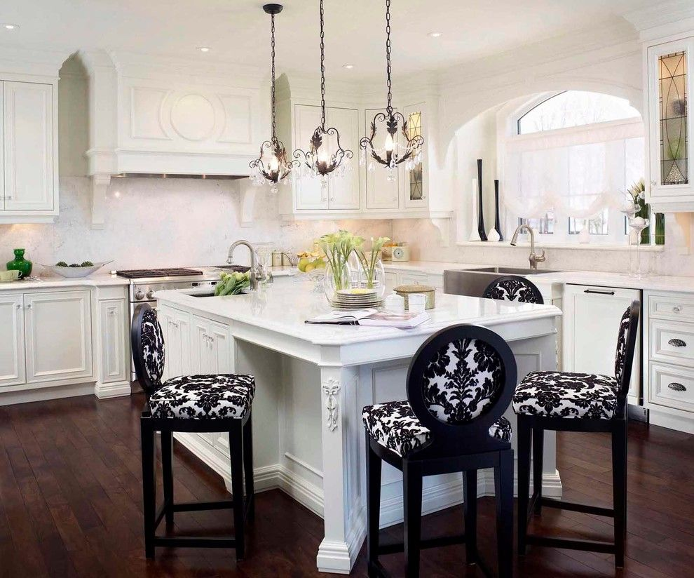Regina Sturrock Design Inc kraus flooring for a traditional kitchen with a carved wood