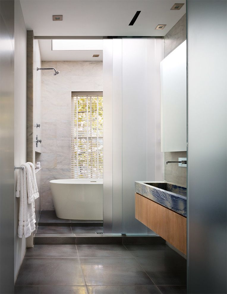 Kraus Flooring for a Transitional Bathroom with a Large Format Floor Tiles and Upper East Side Townhouse by Dineen Architecture + Design