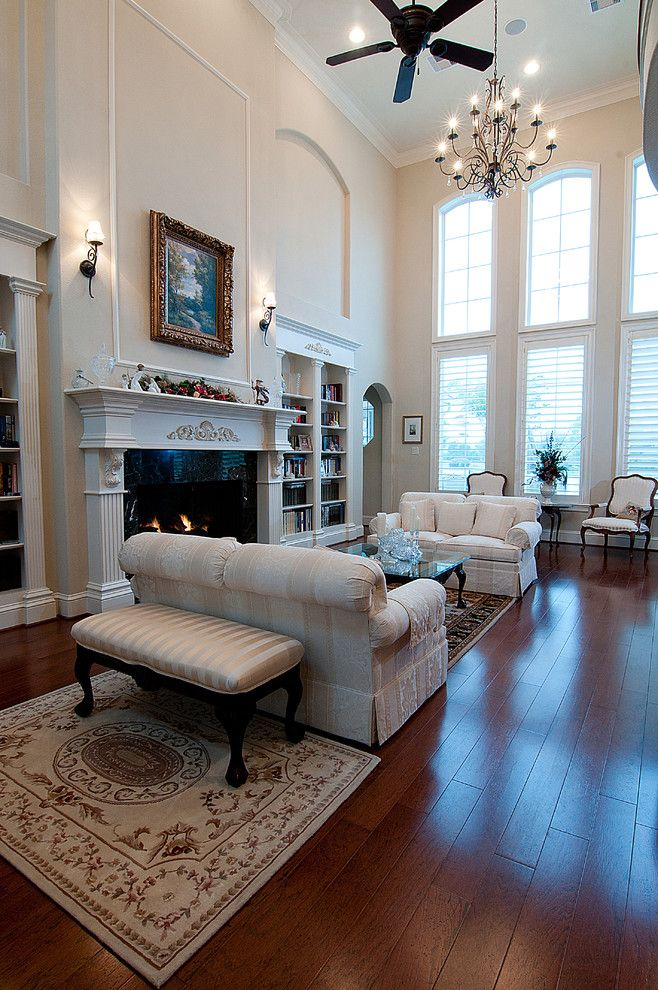 Kurk Homes for a Mediterranean Family Room with a Large Windows and Interiors by Kurk Homes
