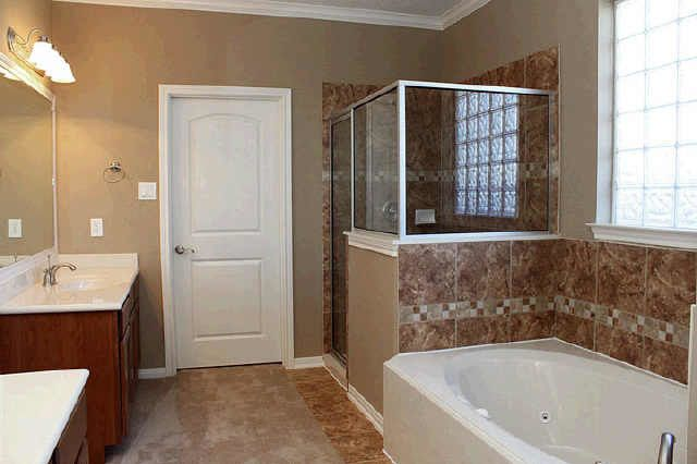 Kurk Homes for a Traditional Bathroom with a Separate Shower and Bathrooms by Kurk Homes