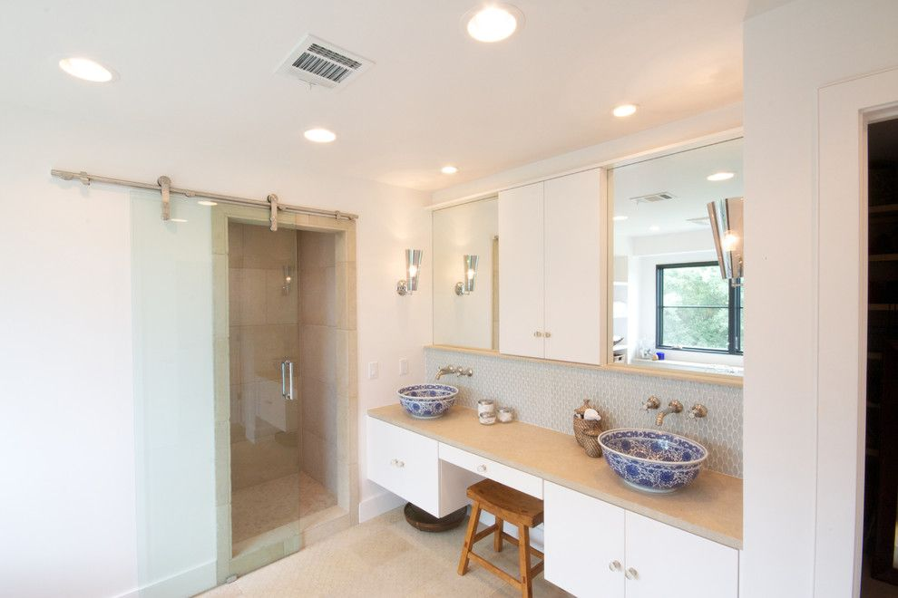 Kuzco for a Contemporary Bathroom with a White Drawers and Master Bath After by Realty Restoration, Llc