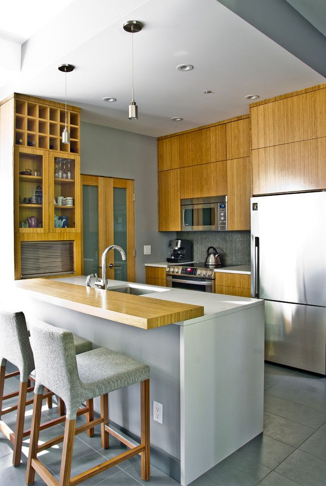 Kuzco for a Modern Kitchen with a Peninsula and Mango Design Co by Mango Design Co