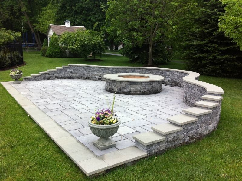 Landscapers Supply for a Traditional Patio with a Firepit and Free Standing Patio with Custom Sitting Wall by Woodward Landscape Supply