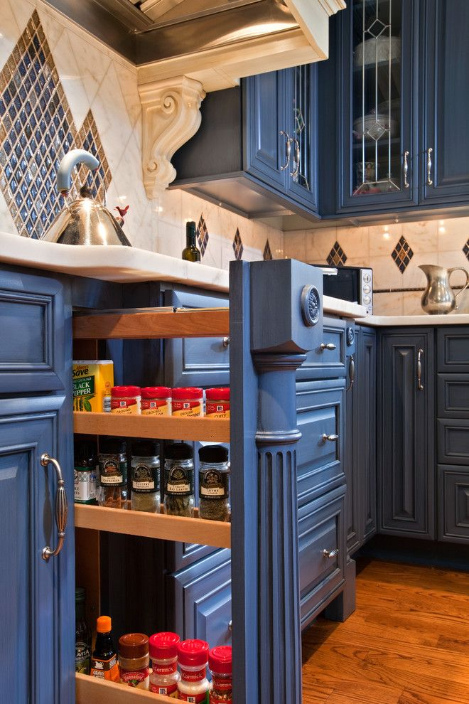 Lantern and Scroll for a Eclectic Kitchen with a Millwork and Colorful Kitchen in Saratoga Springs Ny by Teakwood Builders, Inc.