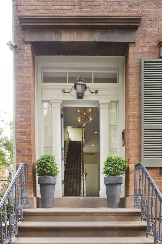 Lantern and Scroll for a Traditional Entry with a Wrought Iron Railing and New York City Townhouse by Dufner Heighes Inc