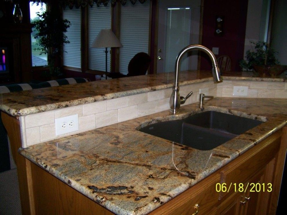 Lapidus Granite for a Traditional Kitchen with a Golden Lapidus and Ctop/bspalsh by Kitchen's + Canyon Granite
