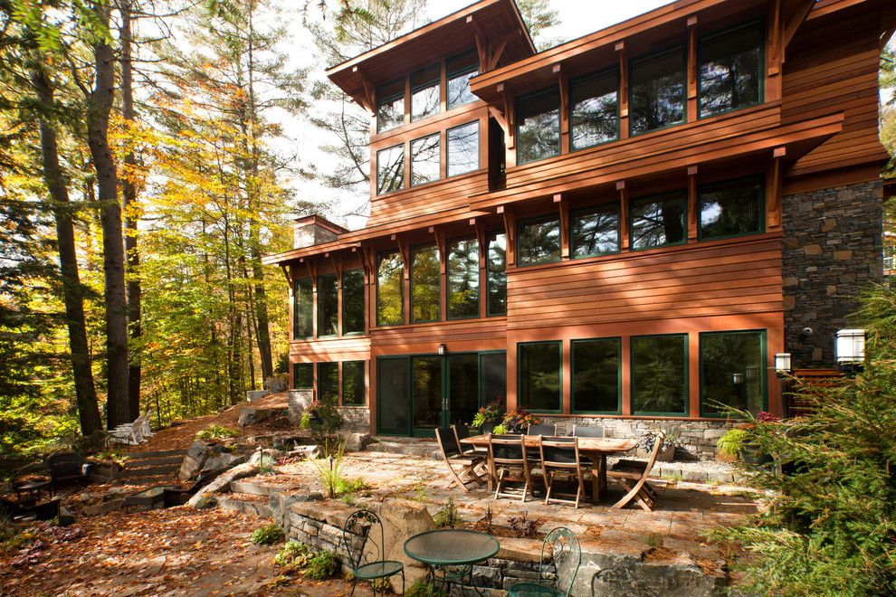Lavalley Building Supply for a Rustic Exterior with a Stone Patio and Lake Luzerne House by Phinney Design Group
