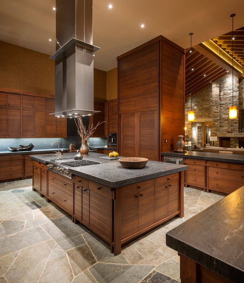 Leathered Granite for a Rustic Kitchen with a Range Hood and Wilderness Retreat by Gregory Carmichael