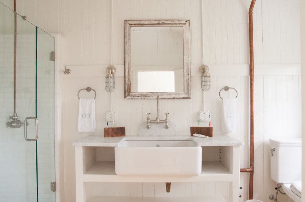 Lefroy Brooks for a Beach Style Bathroom with a Farm Sink and Southern Ct Beach Home by Allee Architecture + Design, Llc