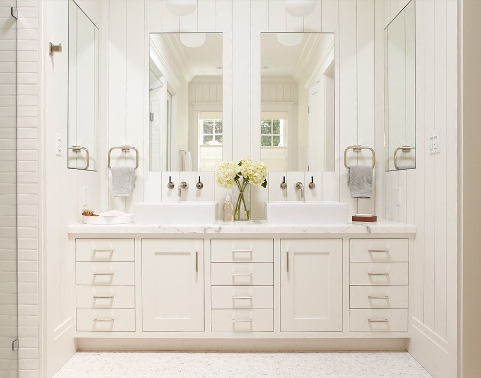 Lefroy Brooks for a Traditional Bathroom with a Black Rock and Master Bathroom, White Vanity with Two Sinks and Large Mirrors by Rasmussen Construction