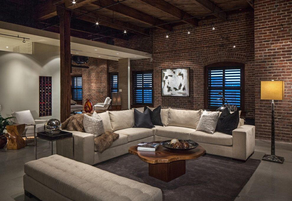 Legacy Homes Omaha for a Contemporary Living Room with a Beige Sofa and Downtown Penthouse by Interiors Joan and Associates