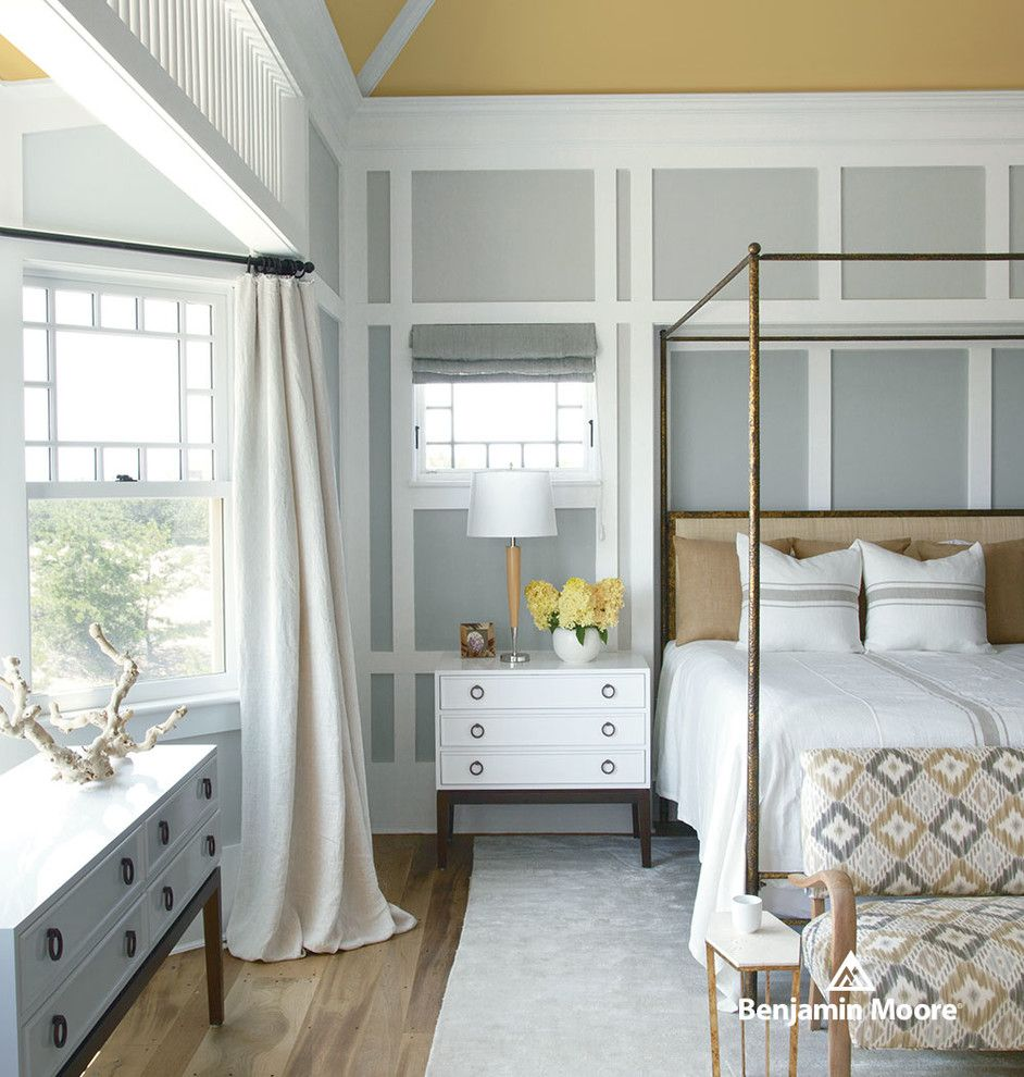 Leirvik Bed Frame for a Contemporary Bedroom with a Yellow Ceiling and Benjamin Moore by Benjamin Moore