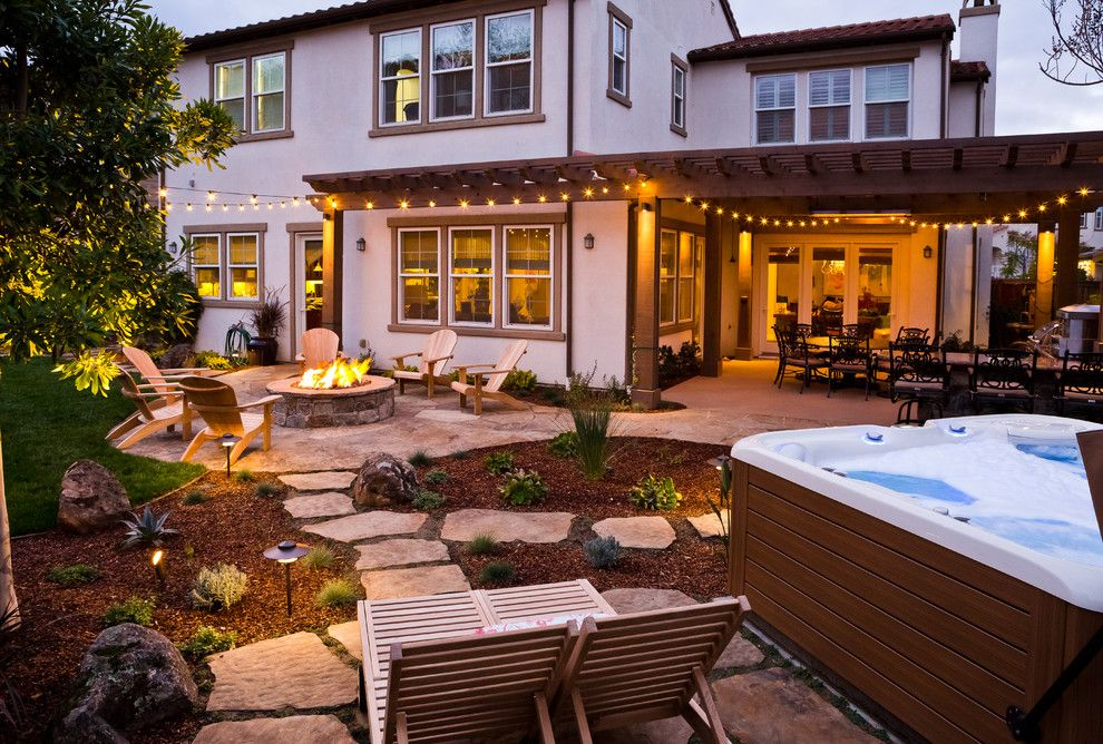 Lifescapes for a Rustic Patio with a Fire Pit and Almaden Retreat by Lifescape Custom Landscaping, Inc.