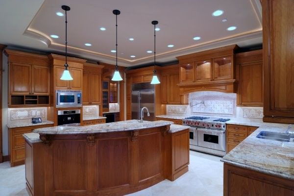 Lighting Emporium for a Traditional Kitchen with a Wolfe and Collection by Viscusi Builders Ltd.