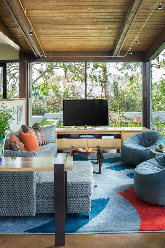 Ligne Roset for a Contemporary Family Room with a Exposed Beams and Tigertail Ridge   Architectural by Susan Jay Design