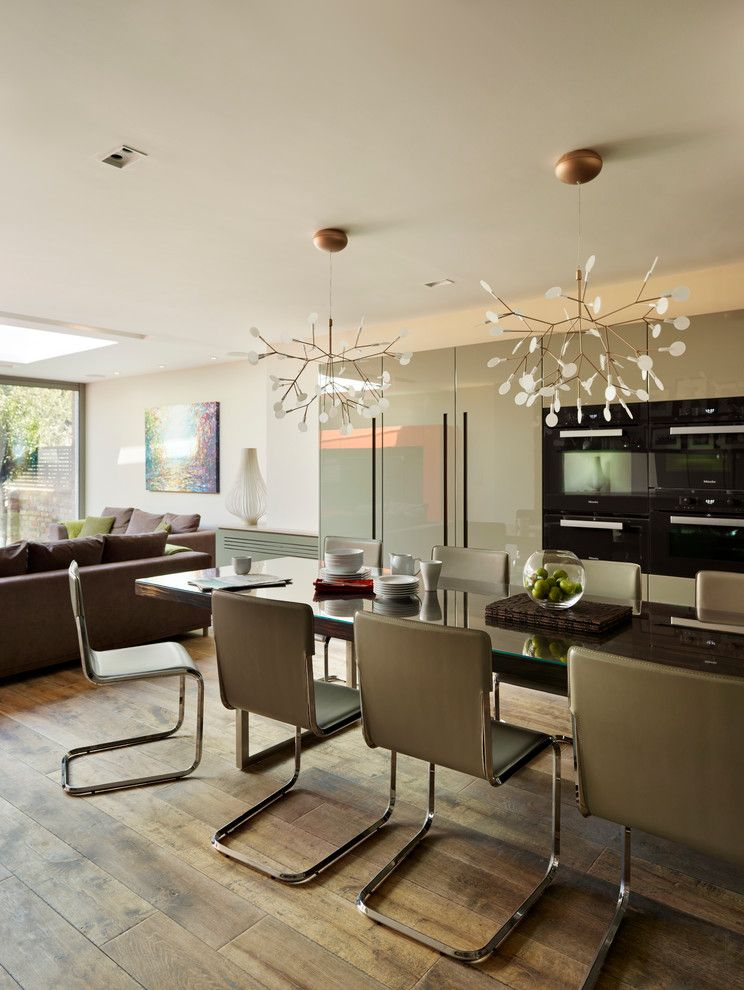 Ligne Roset for a Contemporary Kitchen with a Wall Ovens and Wandsworth Common by Ensoul Interior Architecture