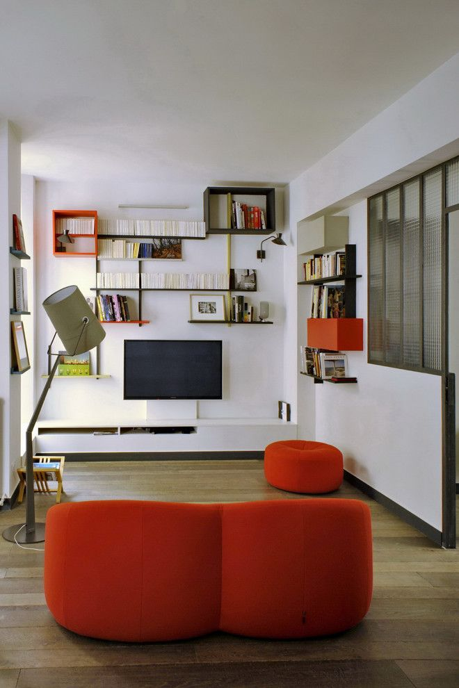 Ligne Roset Nyc for a Eclectic Living Room with a Red Round Couch and Temple by Moc, Maisons Objets & Chantiers
