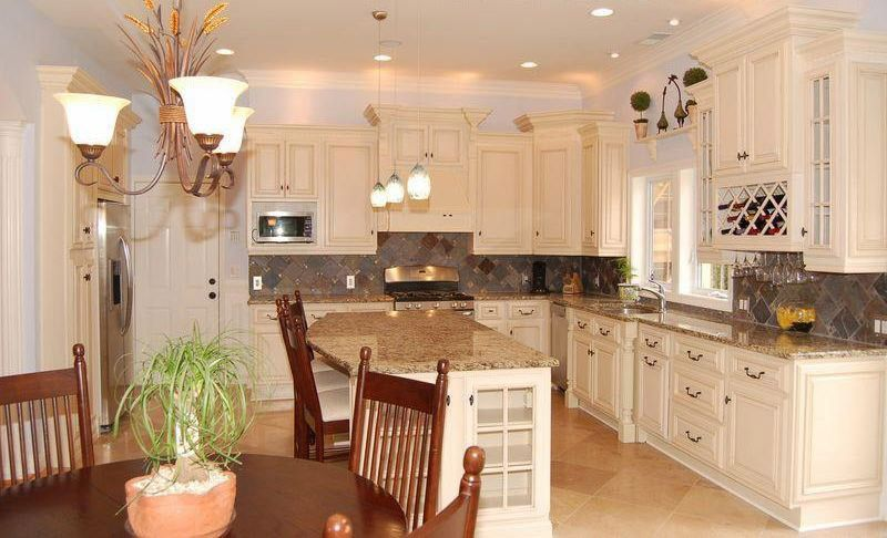 Lily Ann Cabinets for a Traditional Spaces with a Antique White Cabinets with White Applia and Antique White Kitchen Cabinets Home Design by Lily Ann Cabinets