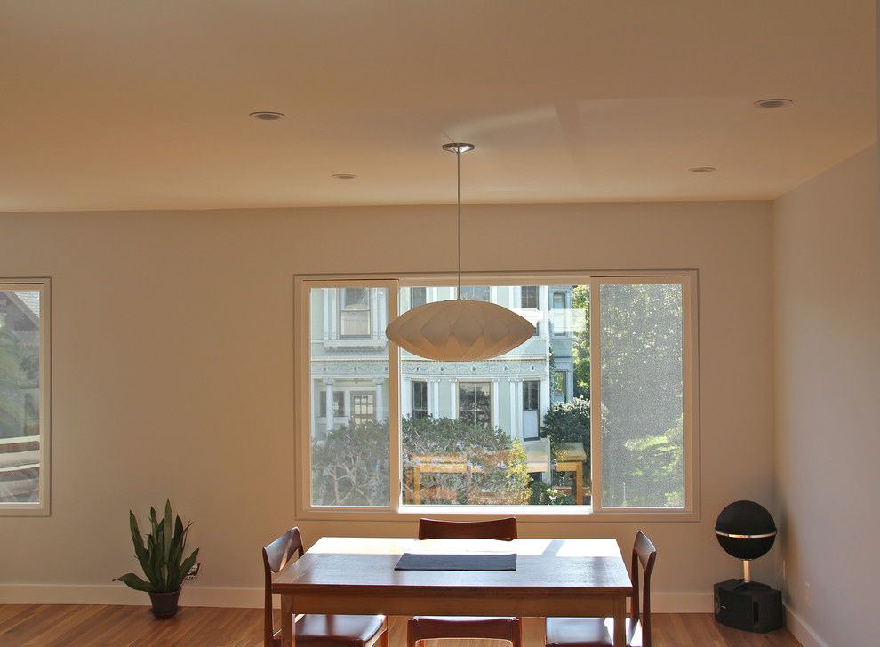 Linnea Hardware for a Modern Dining Room with a Wall Removal and Kitchen and Dining/living Room Remodel by Cardea Building Co.