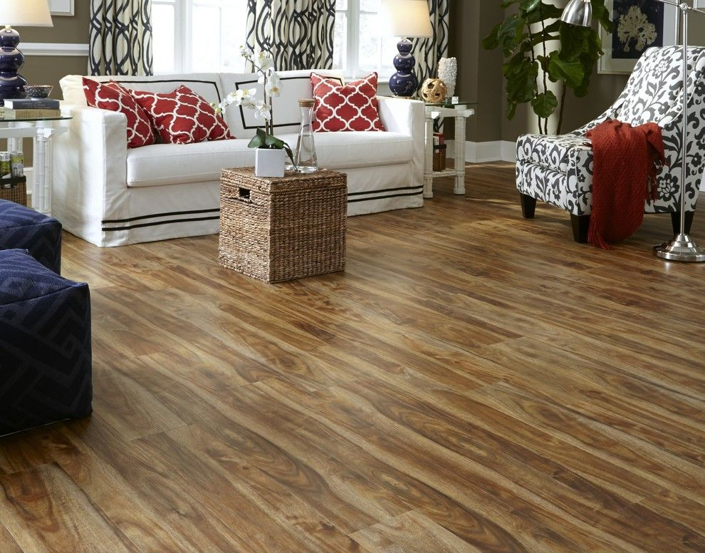 Linoleum vs Vinyl for a Contemporary Spaces with a White Sofa and Tranquility  5mm Rustic Acacia Click Resilient Vinyl Flooring by Lumber Liquidators