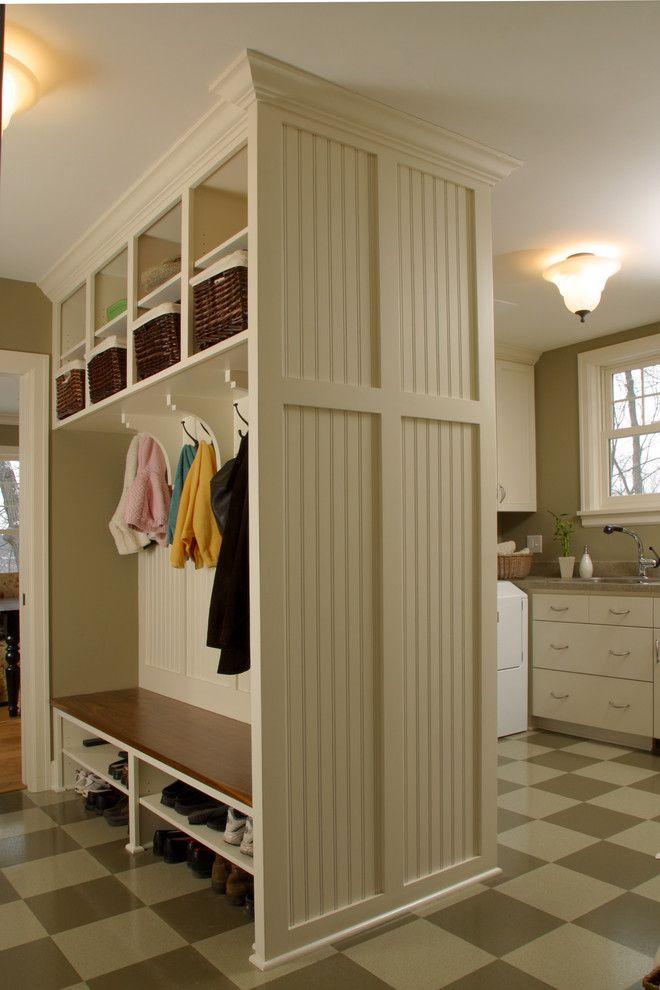 Linoleum vs Vinyl for a Farmhouse Entry with a Laundry Room and Combination Mudroom and Laundry Room by Ron Brenner Architects