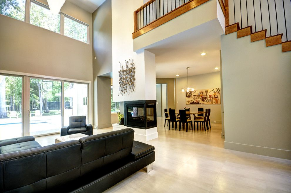 Living Room Color Schemes for a Contemporary Living Room with a High Ceilings and New Custom Home Construction by Fairmont Homes