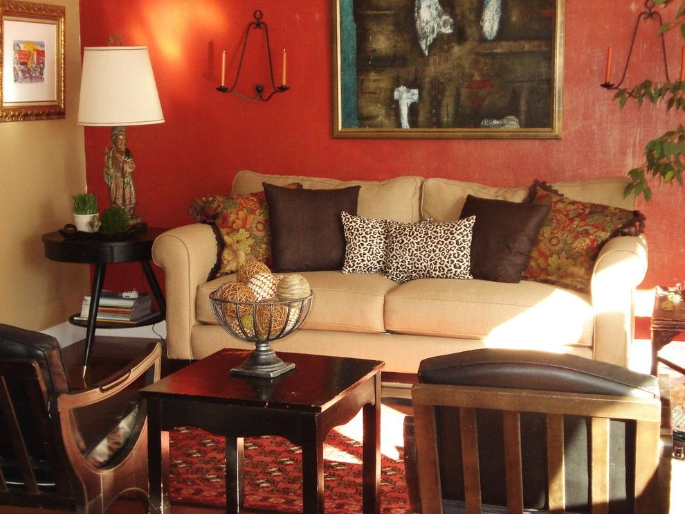 Living Room Color Schemes for a Eclectic Living Room with a Candle Holders and Dumpster Chic Living Room by Judith Balis Interiors