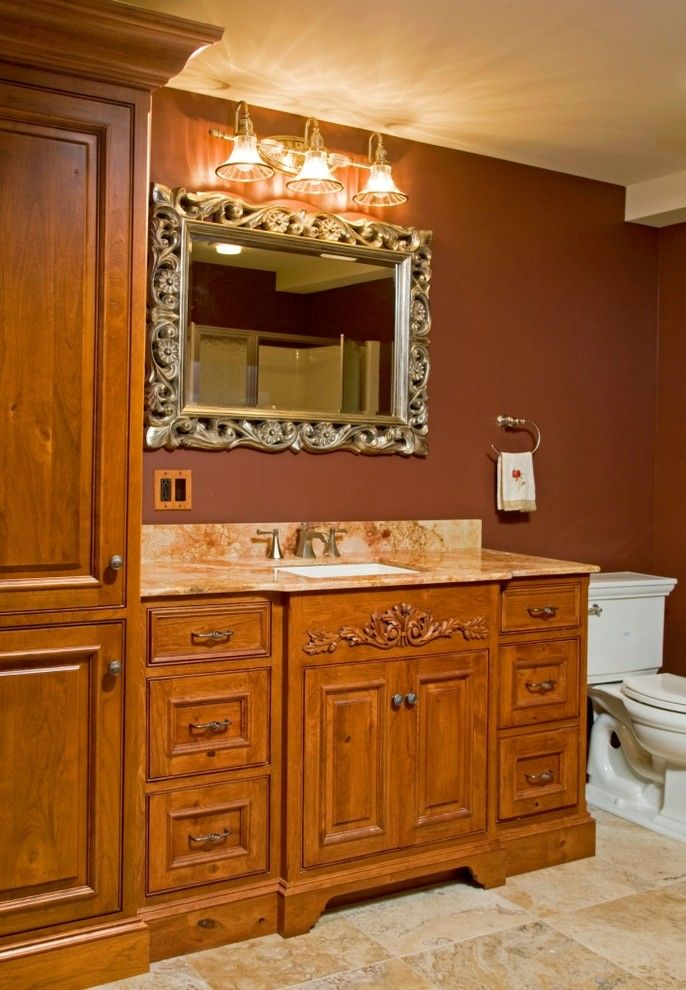 Living Room Color Schemes for a Rustic Powder Room with a Powder Room and Powder Rooms by Superior Woodcraft, Inc.