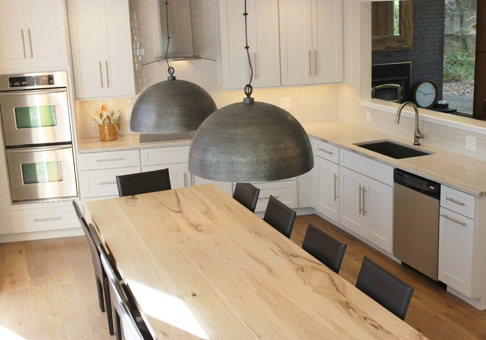 Lockwood Flooring for a Transitional Kitchen with a Extra Large Dining Table and Bettendorf, IA- Kitchen Remodel with Interesting Angled Layout by Village Home Stores